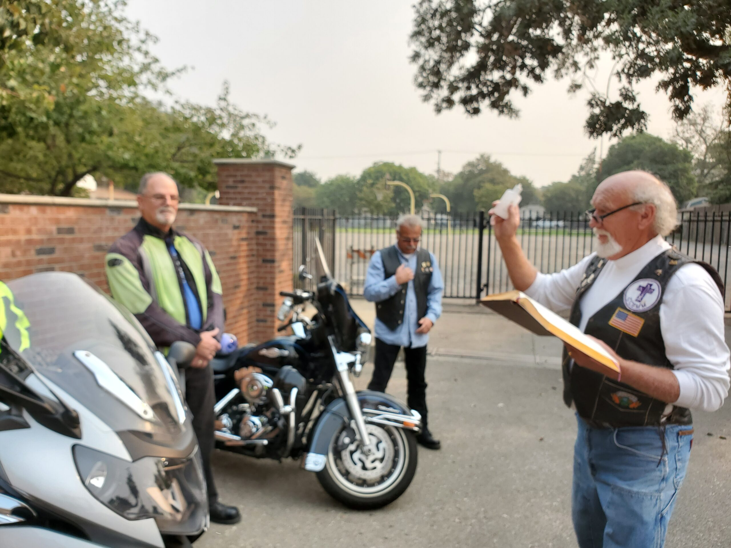 Deacon Greg blessing the bikes